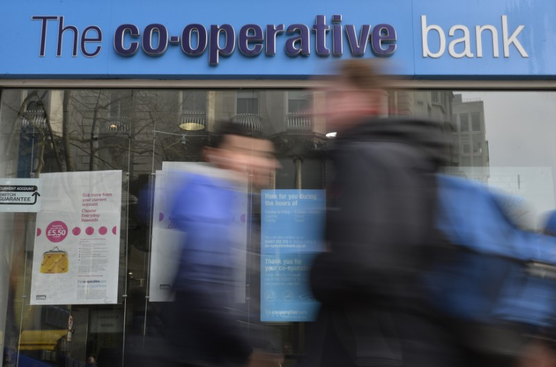 © Reuters. FILE PHOTO:  People walk past a branch of The Co-operative Bank in London