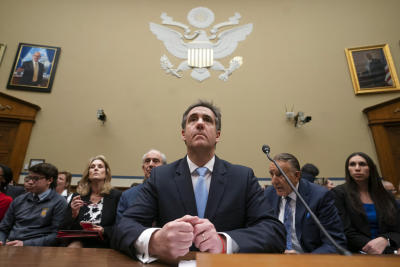 Michael Cohen, President Donald Trump's former personal lawyer, listens as he finishes a day of testimony to the House Oversight and Reform
