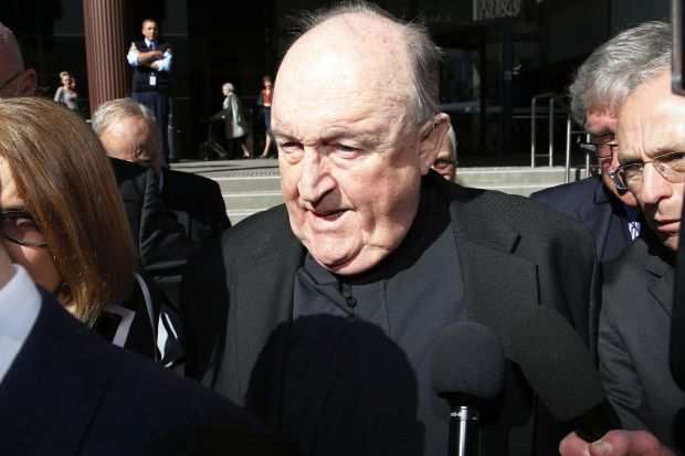 In this Aug. 14 photo, the former Adelaide Archbishop Philip Wilson leaves court in Newcastle, Australia, after a post-sentence decision.