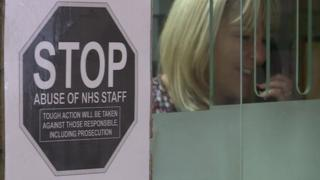 Sign in a GP practice telling patients not to abuse staff members