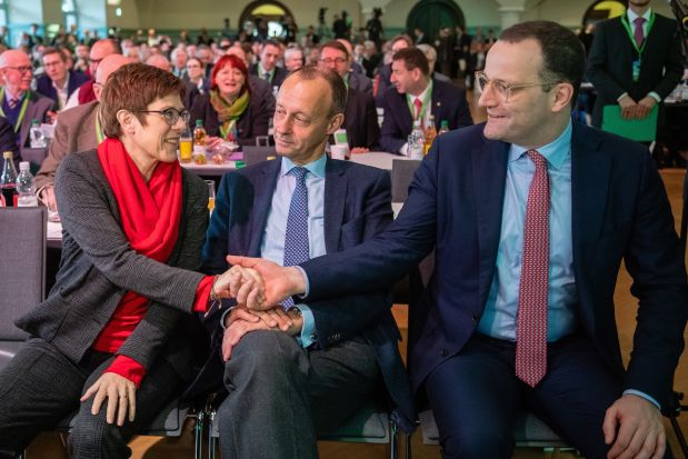 From left, Annegret Kramp-Karrenbauer, Friedrich Merz and Jens Spahn, the candidates to succeed Angela Merkel as leader of the CDU, attending a party event on Saturday in Leipzig.