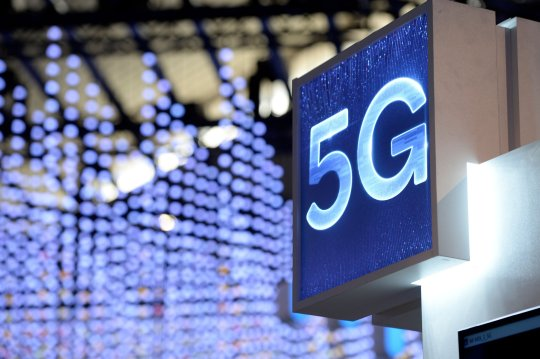 A 5G hotspot sign is displayed at the Mobile World Congress (MWC) in Barcelona on February 25, 2019. - Phone makers will focus on foldable screens and the introduction of blazing fast 5G wireless networks at the world's biggest mobile fair starting February 25 in Spain as they try to reverse a decline in sales of smartphones. (Photo by Josep LAGO / AFP)JOSEP LAGO/AFP/Getty Images