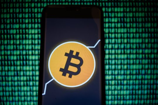 KRAKOW, POLAND - 2018/12/18: Bitcoin wallet logo is seen on an android mobile phone. (Photo by Omar Marques/SOPA Images/LightRocket via Getty Images)