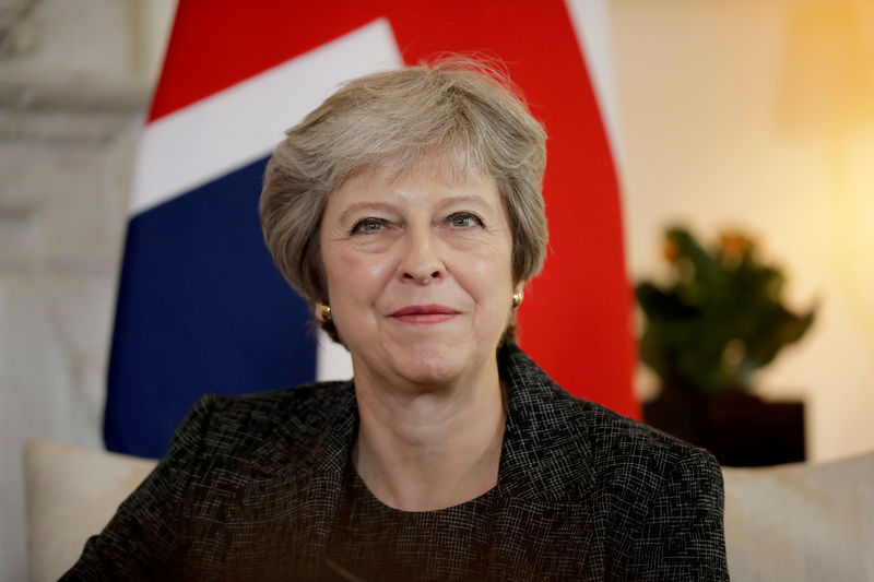 © Reuters.  May Survives Another Vote as She Slowly Brings Opponents Onside