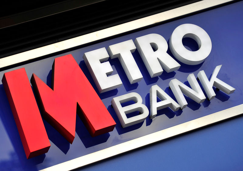 © Reuters. FILE PHOTO: A Metro Bank sign outside one of its London branches