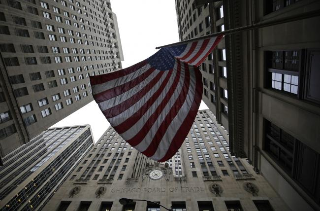 © Bloomberg. An American flag flies outside the Chicago Board Options Exchange (CBOE) in Chicago, Illinois, U.S., on Thursday, Nov. 16, 2017. CBOE's proprietary VIX futures and S&P 500 options businesses continue to be its key growth engines, with a lack of substitutes affording it significant pricing power. Photographer: Jim Young/Bloomberg