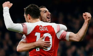 TOPSHOT-FBL-ENG-PR-ARSENAL-BOURNEMOUTH<br>TOPSHOT - Arsenal's Armenian midfielder Henrikh Mkhitaryan (R) celebrates scoring his team's second goal with Arsenal's German midfielder Mesut Ozil during the English Premier League football match between Arsenal and Bournemouth at the Emirates Stadium in London on February 27, 2019. (Photo by Ian KINGTON / AFP) / RESTRICTED TO EDITORIAL USE. No use with unauthorized audio, video, data, fixture lists, club/league logos or 'live' services. Online in-match use limited to 120 images. An additional 40 images may be used in extra time. No video emulation. Social media in-match use limited to 120 images. An additional 40 images may be used in extra time. No use in betting publications, games or single club/league/player publications. / IAN KINGTON/AFP/Getty Images