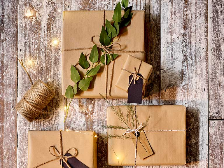 Gifts wrapped with paper and tied with string or twine