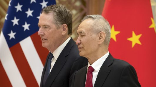 US Trade Representative Robert Lighthizer (L) listens as Chinese Vice Premier Liu He talks while they line up for a group photo at the Diaoyutai State Guesthouse in Beijing on February 15, 2019.
