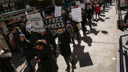 People take part in a protest outside The New York Times on February 26, 2017 in New York.