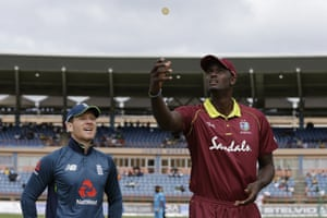 West Indies' captain Jason Holder flips the coin, wins the toss and decides to field.