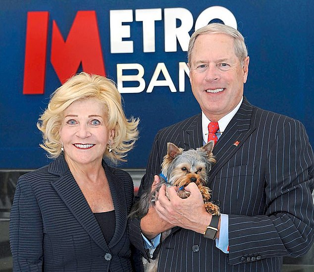 Tycoon: Metro Bank chairman Vernon Hill with his wife Shirley and pet terrier Sir Duffield II