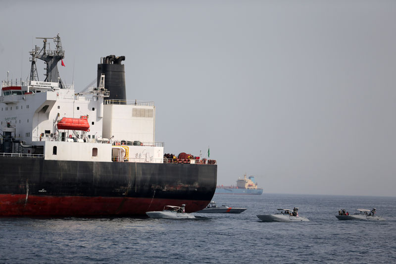 © Reuters. FILE PHOTO: UAE Navy boats are seen next to the Saudi tanker Al Marzoqah off the Port of Fujairah