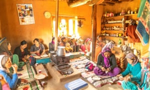 A group photo of travellers and locals   sat on the floor of a traditional house in India. NotOnMap aims to protect farmers and help rural villages become new tourism destinations