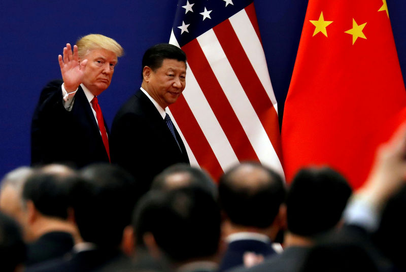 © Reuters. FILE PHOTO: FILE PHOTO: FILE PHOTO: U.S. President Donald Trump and China's President Xi Jinping meet business leaders at the Great Hall of the People in Beijing