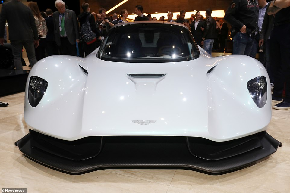 The minimalist wraparound cockpit and curved windscreen reduces visual clutter, says Aston Martin designers