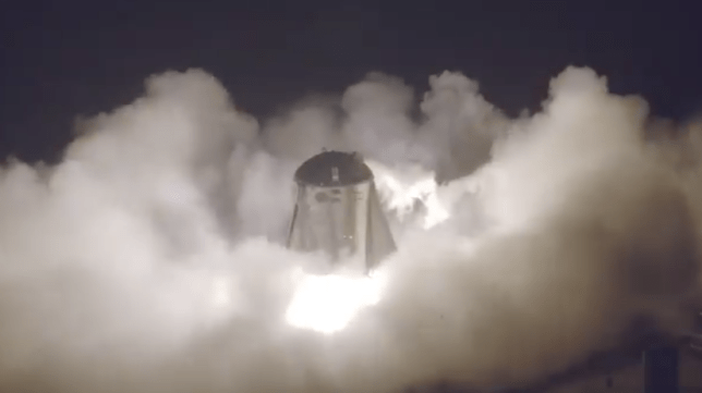 Smoke billows around Elon Musk's Starhopper as it blasts off during a successful test (Image: SpaceX)