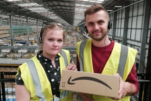 Theatre-makers Kezia Cole and Richard Hay at an Amazon warehouse.