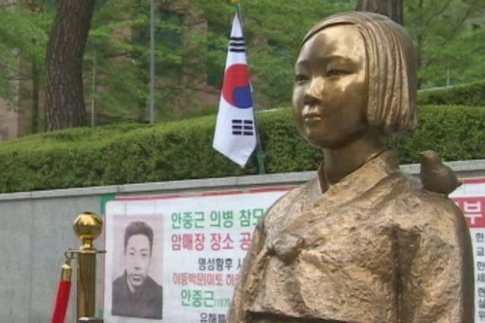 A gold statue of a South Korean woman, part of a monument to those who were subjected to sexual slavery in Japan