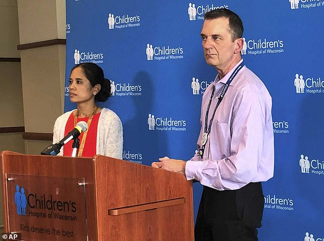 Children's Hospital of Wisconsin Chief Medical Officer Mike Gutzeit and Louella Amos, pediatric pulmonologist, listen during a news conference in Milwaukee, Wisconsin on Thursday, July 25. Doctors suspect vaping caused severe lung damage in eight teens from southeastern Wisconsin hospitalized over the last month