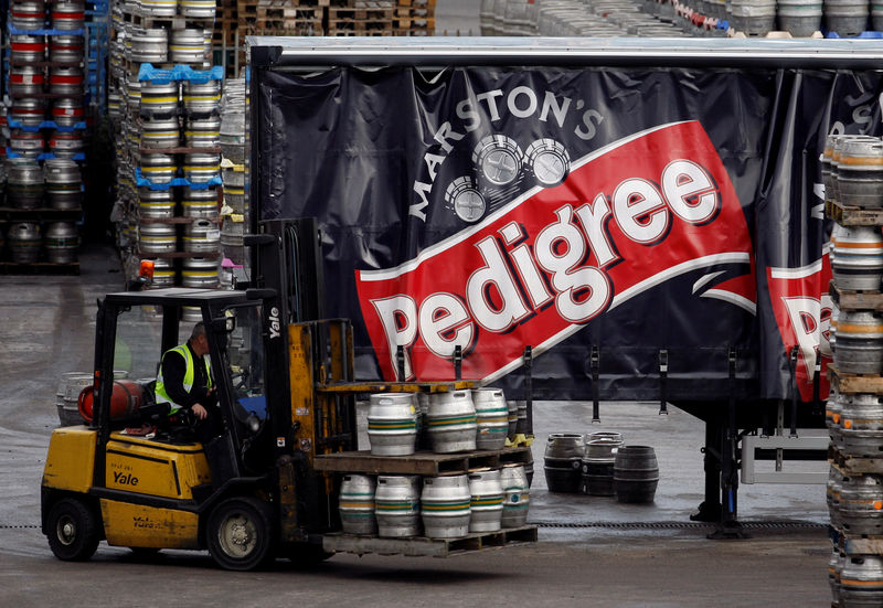 © Reuters. FILE PHOTO: A forklift truck driver loads a lorry with beer at Marston's Brewery in Burton upon Trent