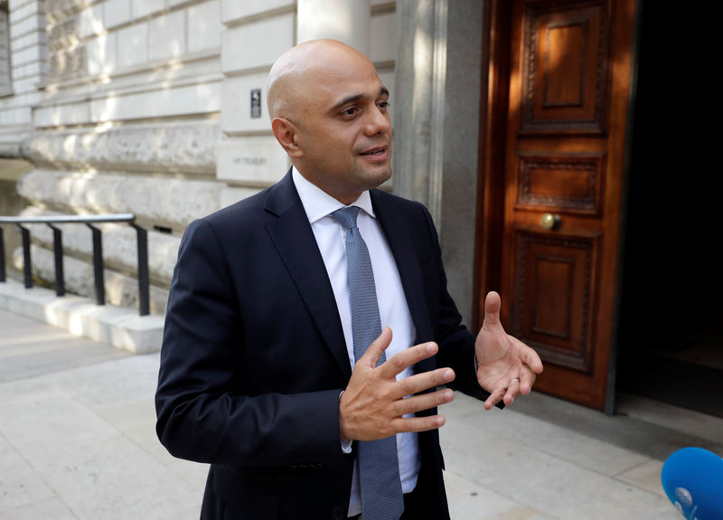 © Reuters. Britain's new Chancellor of the Exchequer Sajid Javid speaks to the media as he arrives at the treasury in London