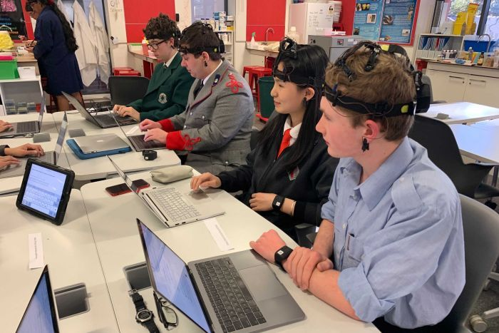 Students wearing ECG headsets while sitting at their computers.