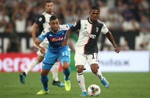 Juventus' Douglas Costa goes past Napoli's Faouzi Ghoulam.