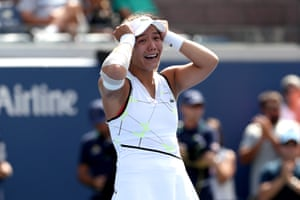 Kristie Ahn of the United States celebrates after beating Jelena Ostapenko.