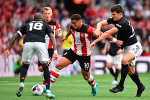Southampton's Che Adams tussles with Manchester United's Harry Maguire.