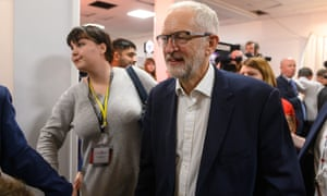 Jeremy Corbyn visits stands at the Labour conference.
