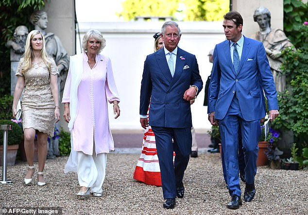 Well connected: Quintessentially co-founder Ben Elliot with his aunt Camilla and Prince Charles