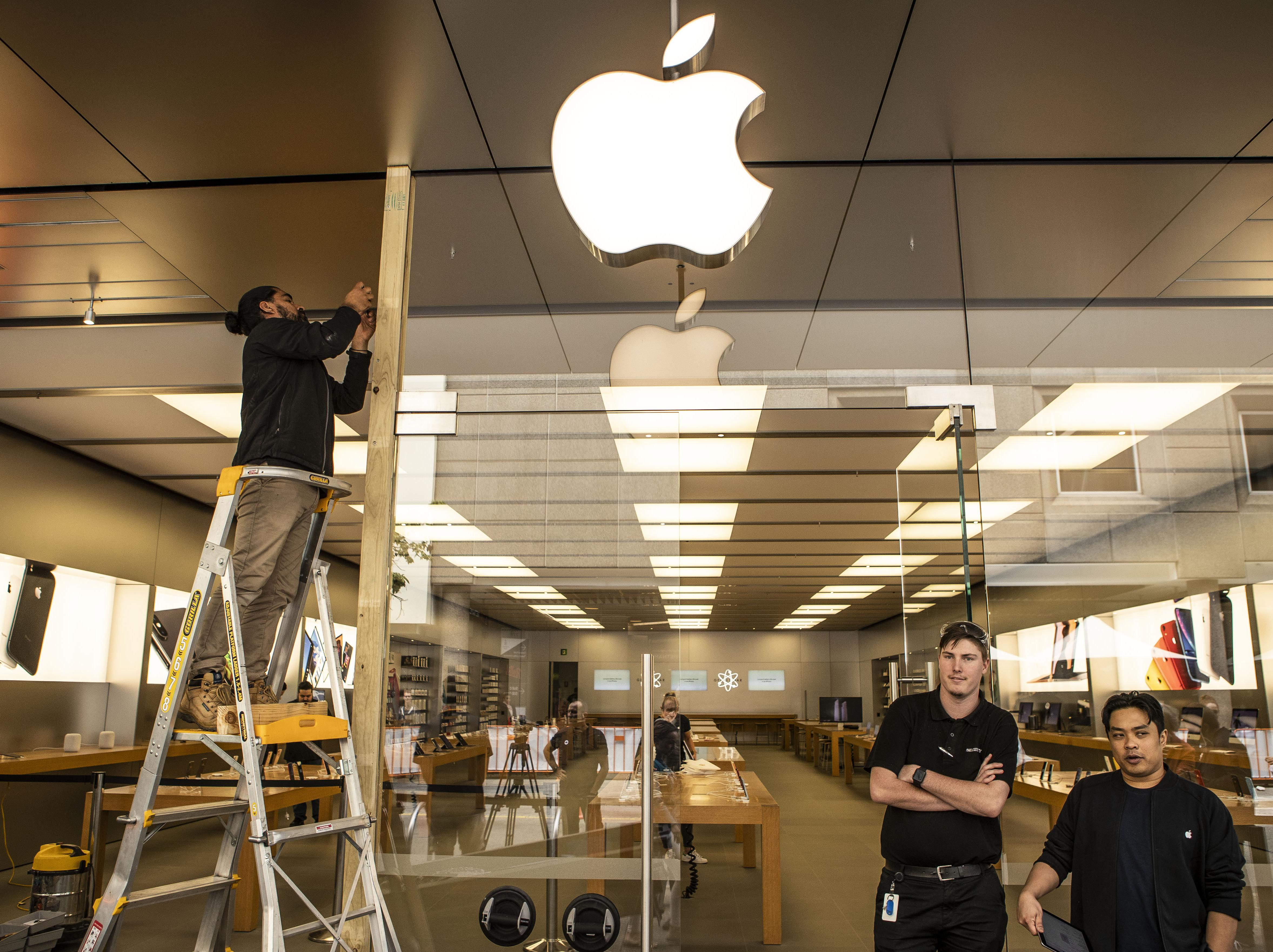 The scene at the Apple store in Perth today where a window was smashed.