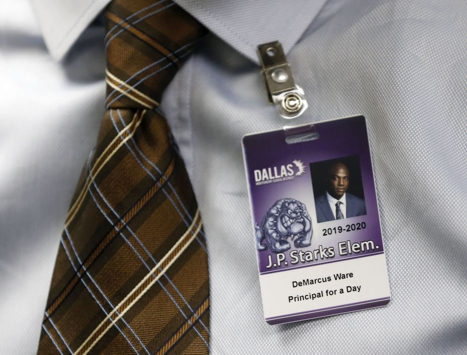 A Dallas ISD identification badge, complete with his photo, was presented to former Dallas Cowboys great DeMarcus Ware for his stint as principal for a day at J.P. Starks Math, Science and Technology Vanguard.