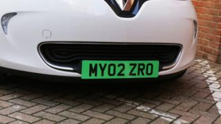 car with green number plate