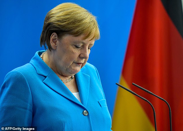 Struggle: In a major setback for Chancellor Angela Merkel and the wider eurozone, the Bundesbank said the German economy contracted again in the third quarter of the year