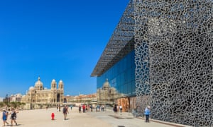 Tourists strolling on the promenade next to the MuCEM,
