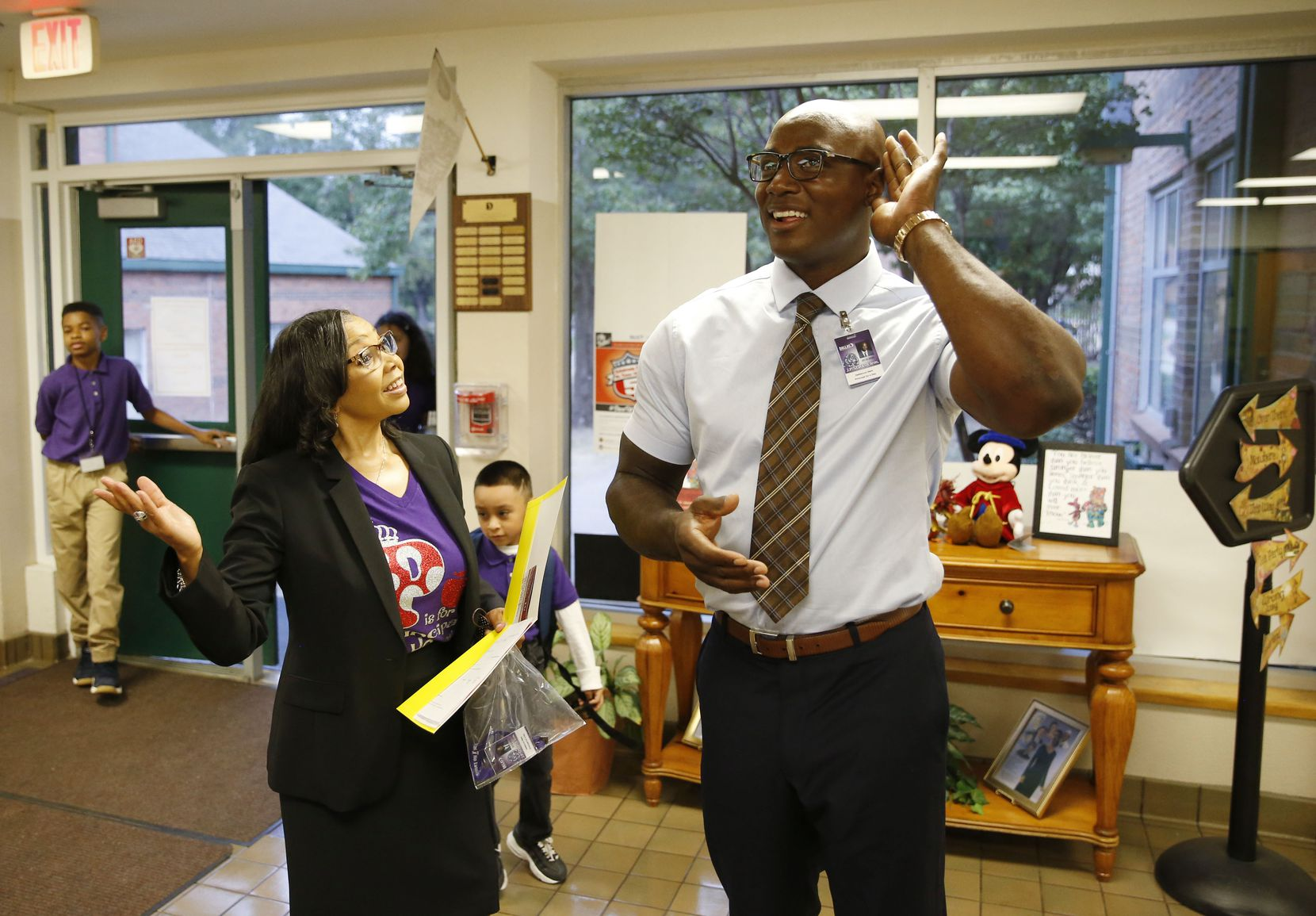 "Ware listens with Starks principal Lynette Howard and students as ""New Day,"" a gospel song by The Walls Group, plays over the intercom."