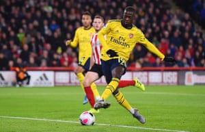An unmarked Nicolas Pepe shoots wide from close range.