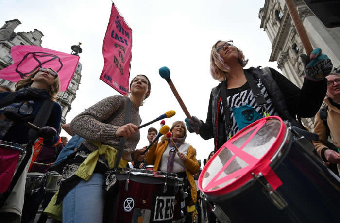 Activists join a musical protest in Whitehall