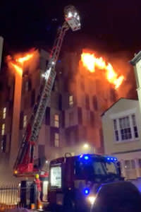 A student accommodation building on fire is pictured in Bolton, Britain November 15, 2019, in this picture grab obtained from a social media video. NATHAN DOONER/via REUTERS THIS IMAGE HAS BEEN SUPPLIED BY A THIRD PARTY. MANDATORY CREDIT. NO RESALES. NO ARCHIVES.