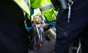 Police clear and arrest protesters from Trafalgar Square in October 2019.