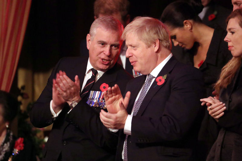 © Reuters. Britain's Prince Andrew and Prime Minister, Boris Johnson, attend the Festival of Remembrance in London