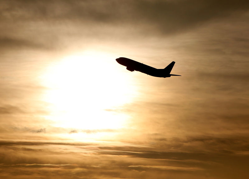 © Reuters. FILE PHOTO: A plane is seen during sunrise at the international airport in Munich