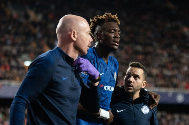 Tammy Abraham in some pain as he leaves the field during Chelsea's draw with Valencia in the Champions League
