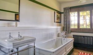Bathroom at one of the Winsford Cottage Hospital bedrooms to feature a bath. Devon, UK.