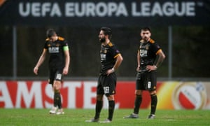 Wolverhampton Wanderers' Joao Moutinho and teammates look dejected after Braga's Fransergio scores their third goal and puts the home side back on level terms.