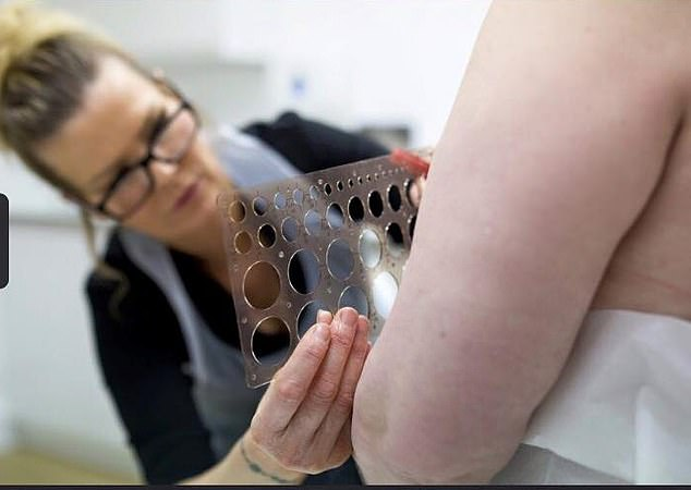Vicky can be seen at work, sizing up the stencil for the tattoo. Facebook refused a meeting with the tattoo artist but did apologise when questioned later