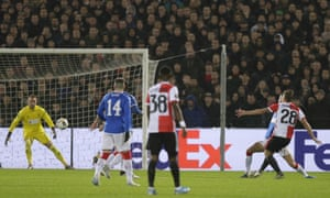 Feyenoord's Jens Toornstra, right, shoots and the ball ends up in the Rangers net via a deflection.