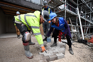 Jo Swinson visits an eco home building site in Sheffield